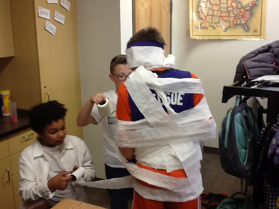 Mr. Anderson's class making each into a mummies!
