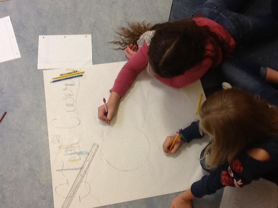 Designing their poster